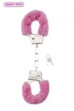 Menottes fourrure Shots - rose : Paire de menottes fantaisie qui ferment comme des vraies pour jouer à s'attacher. En métal et fausse fourrure rose.